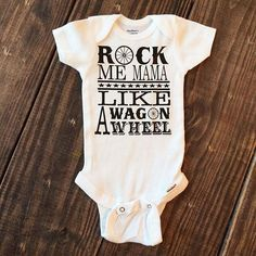 7209b7ff8 Rock Me Mama Onesie Available in White. Made of cotton rib for extra give  in the belly area Lap-shoulder nec
