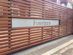 house number set into horizontal slatted wood fencing || Lothian Gates