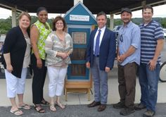 """We're thrilled to announce the Little Free Library is BACK at West Meadow Beach for the summer, and Councilwoman Valerie M. Cartright attended the installation to show her support of this outreach service to the community! ************ The structure was made from recycled materials by library employee James Krause and is being maintained by teen volunteers. There's no need for a library card or to return a book – this is a """"take a book, leave a book"""" concept.  Special thanks to Town of…"""