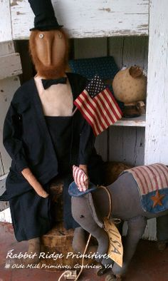 Abe Lincoln doll by Rabbit Ridge Primitives; Elephant Pull Toy made using a Crabby Gabby pattern.  Available at Olde Mill Primitives, Goodview, VA