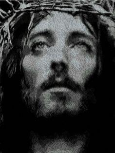 Jesus-Cristo en punto de cruz.