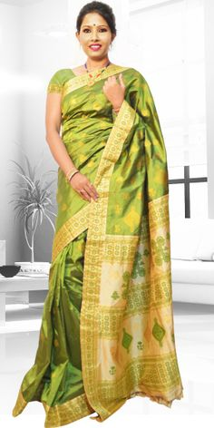 Beautiful Green colour Assam silk Pat saree  with artistic Guna  work of round buta giving an ethnic look to the collecion. The saree is known as VIP because anchal part is stitched seprately with the saree. The Saree comes with 2 matching blouse pcs. one is of body colour and other is of anchal colour, the blouse shown in the image is just for display purpose.Slight colour variation may be there in display & actual.