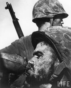 Magnum photographer, W. Eugene Smith's, picture of a Marine drinking from his canteen during 1944′s Battle of Saipan