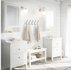 IKEA bathroom white Medicine cabinets, hooks on wall, storage between basins, wood panelling, sheer curtain ( needs pattern)