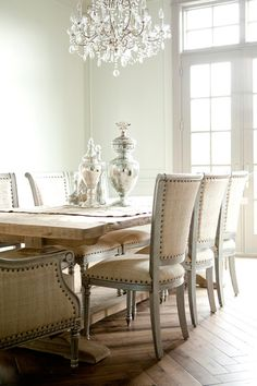 Light wood farm table with neutral fabric chairs