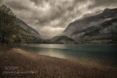 Rainy day by aniryazul  sky lake cloudy rain mountain green water Italy Garda Tenno Lake Rainy day aniryazul