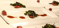 """Winter Hunt: venison, grape jus, braised kale """"This dish is following the theme of fall harvests & hunting. It features ingredients traditionally available in Colorado."""""""
