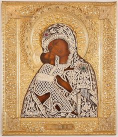 """RUSSIAN ICON, FEODOROVSKAYA MOTHER OF GOD with finely detailed gilt silver and seed pearl oklad with raised halo. Mary is embracing the Christ with his arm around her neck and cheeks touching.  The oklad is marked on the bottom edge with maker's mark, assayer mark (A. Romanov), 1889, Moscow mark, and 84 silver standard mark (.875 fine silver).  12.25"""" x 10.5"""""""