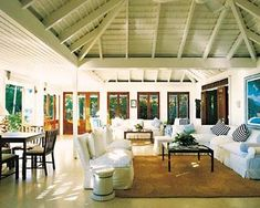 A living room in one of Round Hill resort's cottages with furnishings from Ralph Lauren Home.