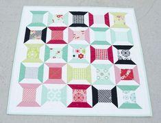 Free pattern @ Hyacinth Quilt Designs: Tumbling Spools Mini-quilt