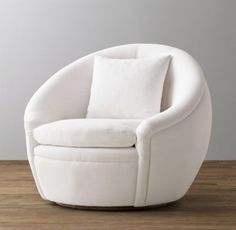 RH Baby & Child's Oberon Upholstered Swivel Chair:Reminiscent of a nest – and just as cozy – our swivel chair offers an ideal spot to curl up and cuddle. Its rounded silhouette has a modern aesthetic, while rolled arms and button tufting along the cushioned back give a nod to classic furniture design.