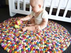 Love these felt ball rugs! Too bad real felt balls are so expensive.