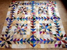 scrap quilt made with 1/2 square triangles