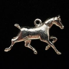 """Sterling silver charm of a race horse or thoroughbred horse. The design is on both sides of the charm. Condition is very good to excellent. The charm measures 3/4"""" x 1/2."""" There are no marks or hallma"""