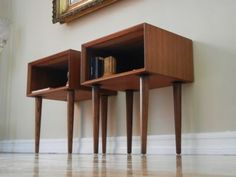 "For Auction is this gorgeous Pair of Mid Century Danish Modern Teak Nightstands or Side Tables. These table has been refinished by a professional and are in Great Condition. a great additon to any room. The tables are marked ""Made In Denmark""."