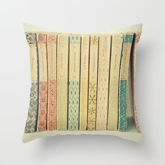 Make any couch instantly awesome with a book throw pillow | 30 Totally Unique Ways To Decorate Your Home With Books