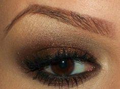 brown eyeshadow, black eyeliner & mascara, arched brows by mono.goda