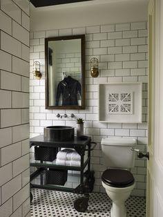 Large Subway Tile, Dark Grout, Black Toilet Seat, Wall Mounted Taps.