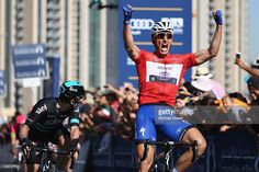 Marcel Kittel (R) of Germany and Etixx Quick Step celebrates the stage win and overall victory from Elia Viviani (L) of Italy and Team Sky during the Business Bay Stage Four of the Tour of Dubai on February 6, 2016 in Dubai, United Arab Emirates.