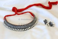 Tribal style statement neklace in silver tone finish. Thushi is a traditional Maharashtrian jewellery from Peshwa dynasty. Maharashtrian jewellery is particularly known for its gracefulness. Thushi Ne