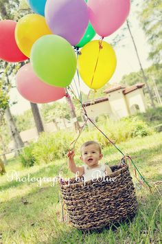 """Kinley's """"One Year"""" photo-session; hot air balloon basket."""