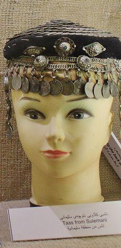 Festive woman's hat.  Kurdish, from Sulemani/Sulaymaniyah (Iraqi Kurdistan, near the Iranian border), ca. 1900-1950.   Sulemani is the cultural center for Sorani-speaking Kurds (which is the Central Kurdish dialect spoken in Iraqi Kurdistan, as well as in the Kurdistan Province of western Iran).  (Kurdish Textiles Museum, Erbil, northern Iraq).