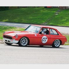 Chris Longo: My 1968 MGB GT running in the Pittsburgh Vintage Grand Prix Schenley Park race course. Tons of parts ordered from Moss, including windshield, windshield aluminum trim, all rubber gaskets/seals, tons of engine parts, 15 Panasport wheels, and all what little chrome is on her (gotta keep her weight down since she's a race car!)