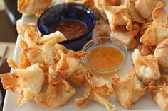 Crab Rangoon - next time I'll add more cream cheese. I use Peanut Oil to cook them in. Because I don't have a thermometer, I cut a piece of the dough to see how fast it would cook. It took less than 3 minutes. Good thing...you can add as much filling as you want!
