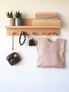 This is a 55cm entryway organiser, made from Tasmanian oak wood that has a mail holder, shelf and coat racks. Perfect for your entryway to hang all your jackets, coats, hats, bags etc. It also has a place for all your mails, bills, and paper documents in the mail holder. And you can place all the other stuff like decoration, wallets, sunglasses, keys on the ledge/shelf. #entrywayorganizer #entrywayorganiser