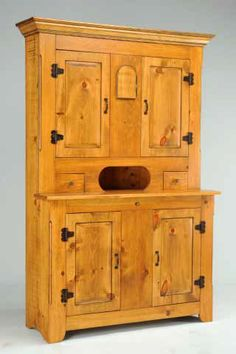 Quebec Hutch Cupboard. Made from authentic old world wide plank pine, this replica of a mid 1800's Quebec Hutch Cupboard features wide plank pine construction. Continuity of the grain direction continues from right to left with no joints or seams. Solid plank doors render a raised panel effect. Iron hinges are handmade with added distress marks and rust to create authentic old world charm. Adjustable shelves and pie cooling area add to the functionality of the piece. Raised Panel, Wide Plank, Old World Charm, Adjustable Shelving, Quebec, Cupboard, Rust, Pine, Iron