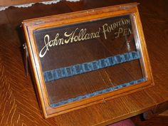 JOHN HOLLAND FOUNTAIN PEN store display case with gold leaf lettering.
