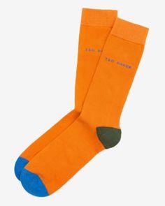 £8.50 http://www.tedbaker.com/uk/Mens/Accessories/Socks/BRIXEN-Colour-block-socks-Dark-Orange/p/117076-80-DARK-ORANGE