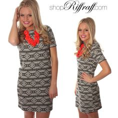 Pretty dress.  Would look cute with leggings and black flats for work with a bright necklace to add a pop of color and fun