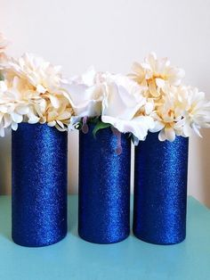 Set of 3 Beautiful Royal Blue Glitter coated Glass Cylinder Vases. The vases in this particular listing are decorated in Royal Blue glitter, and sealed to reduce glitter shedding. Flowers and accessor Blue Party Decorations, Blue Wedding Centerpieces, Bridal Shower Centerpieces, Wedding Vases, Wedding Blue, Quinceanera Decorations, Trendy Wedding, Wedding Ideas, Mantel Azul