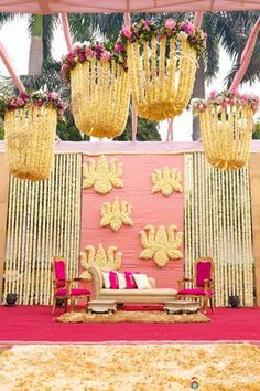 Stunning wedding decor inspiration | Hanging floral garlands as drapes | Flower Chandeliers | Pastel wedding decor | Pink and white floral decor | Stage backdrop in lotus flower motifs | Credits: Avnish Dhoundial Photography | Every Indian bride's Fav. Wedding E-magazine to read. Here for any marriage advice you need | www.wittyvows.com shares things no one tells brides, covers real weddings, ideas, inspirations, design trends and the right vendors, candid photographers etc.