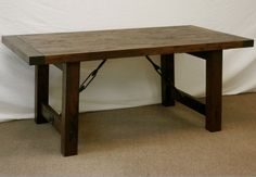 I want this handmade rustic dining table from Doucette and Wolfe Furniture.