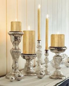 Candlesticks of all heights in the same hue...love this!