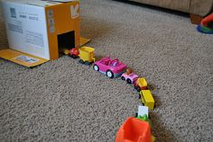Great example of finding ways to support play at home based on your child's interests. If your child loves the car wash, she's likely to really enjoy playing with a homemade car wash. Cardboard boxes can become almost anything-- let your imagination go wild.