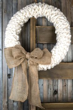 Make this rustic wreath in less than 30 minutes without any tools! We show you the quick step by step process to make a jumbo yarn wreath for your winter decorating. Add a bit of farmhouse charm to your holiday decorations. Holiday Wreaths, Holiday Crafts, Christmas Crafts, Christmas Decorations, Winter Wreaths, Xmas, Knit Christmas Ornaments, Spring Wreaths, Summer Wreath