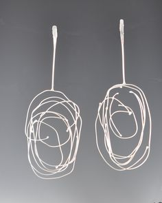Long Birdsnest Earrings by Lori Gottlieb. Light as a feather, these earrings are made out of argentium silver (tarnish resistant silver). They have a big visual impact, but are virtually weightless.Post backs.