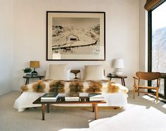 The master bedroom has a low oak bed with an Andreas Gursky photograph hanging above it.