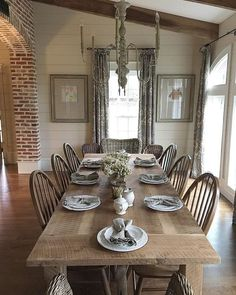 Classic country dining room with windsor chairs, French chandelier, shiplap, and spare decor. #countrydiningroom