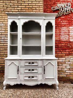 Professionally painted vintage French provincial hutch in white. Modernized, vintage, refinished furniture from Carver Junk Company. http://www.carverjunkcompany.com