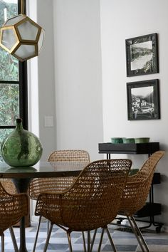 by Nate Berkus. Modern, wood, white walls, statement chairs that are also comfortable