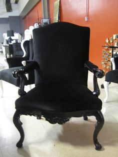 4053 BLACK VELVET BAROQUE CHAIR This chair is simple, elegant and sophisticated. The frame is ornately carved and painted with a glossy, black lacquer finish, adding shine to the design. It is then completed with the finest black velvet, making it a wonderfully beautiful, monochromatic addition to your home.