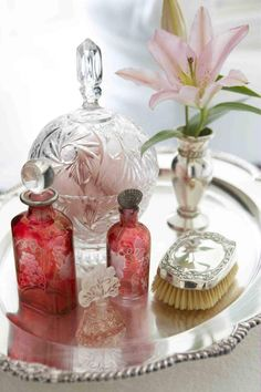 Lovely dressing table vignette. Cranberry glass perfume bottles & silver.
