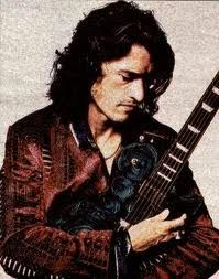 joe perry holding his blue rose..