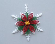 Quilled Christmas Ornament, Snowflake with Quilled Poinsettia. $8.00, via Etsy.