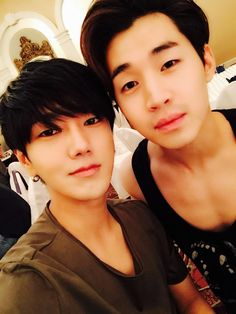 Yesung + Henry. Henry looks older than Yesung. WOAH