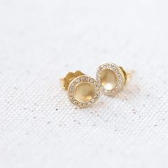 Lilydust Stud Earrings  --- They may be small but they make a sparkling statement with their white diamond pave rim set in 18k yellow gold.